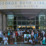 IASW students standing in front of the George BUsh Library and museum at U of H.