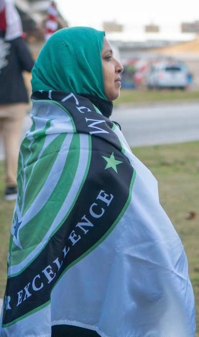 Middle/High School Principal wearing an Iman Academy Flag